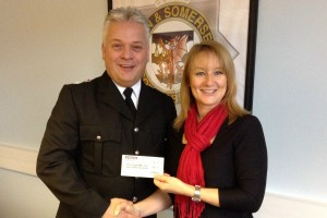 Here I am handing a cheque to the Police Dependants' Trust to my District Commander Geoff Spicer.
